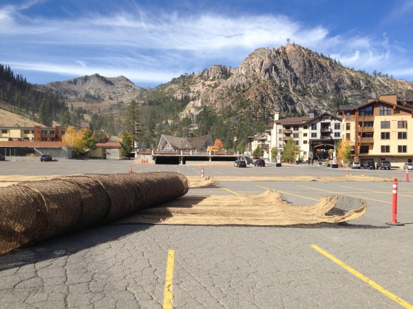 Burlap and mesh sheets in the Squaw parking lot await placement by helicopter onto lower mountain ski runs.