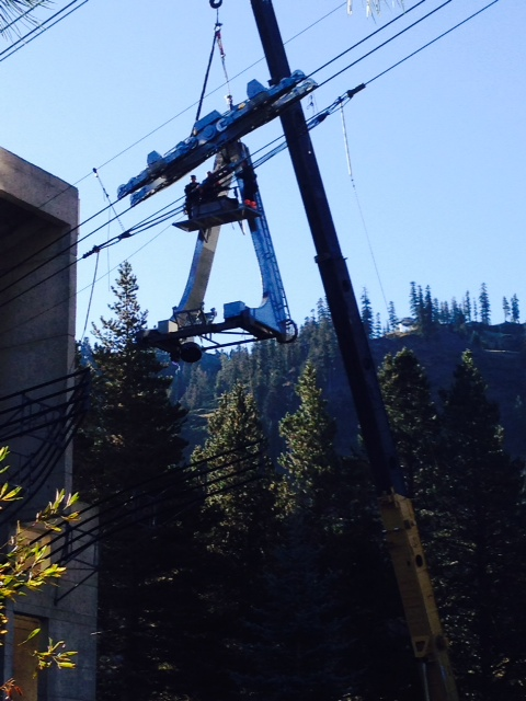 Crews work on the hanger of the Squaw tram during annual fall maintenance.